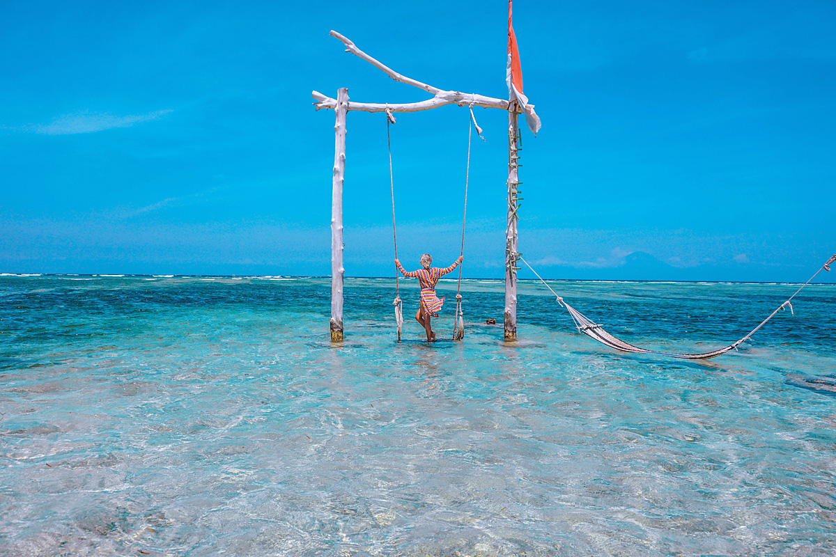 Swinging on the beach of Gili Trawangan.