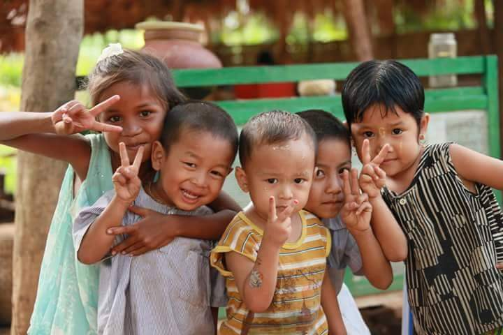 Local children smiling in Gili Air in the Gili islands in Indonesia.
